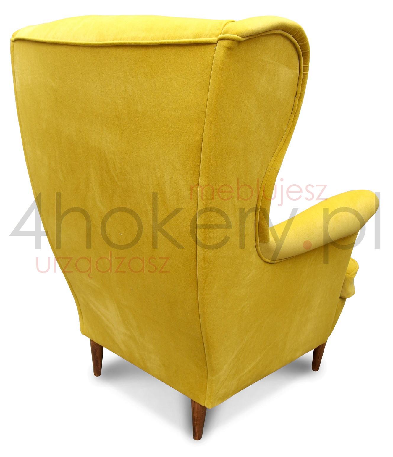 Żółty wygodny fotel uszak Piękny fotel